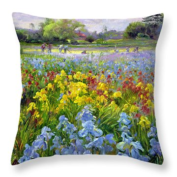 Hoeing Team And Iris Fields Throw Pillow by Timothy Easton