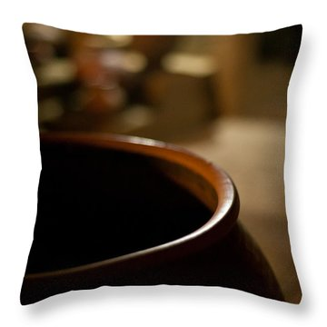 Holding Throw Pillow by Mike Reid