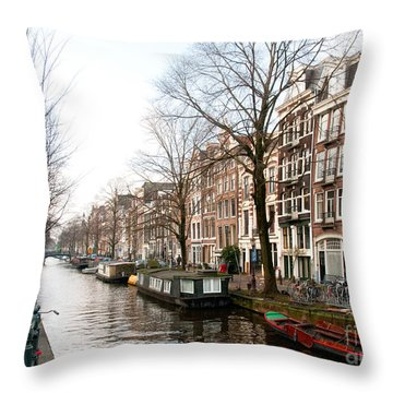Throw Pillow featuring the digital art Homes Along The Canal In Amsterdam by Carol Ailles