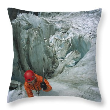 Ice Climber On Steep Ice In Fox Glacier Throw Pillow by Colin Monteath