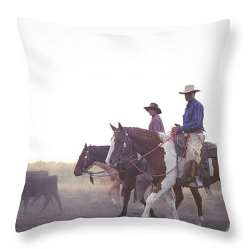 In The Saddle Throw Pillow by Peter Mooyman