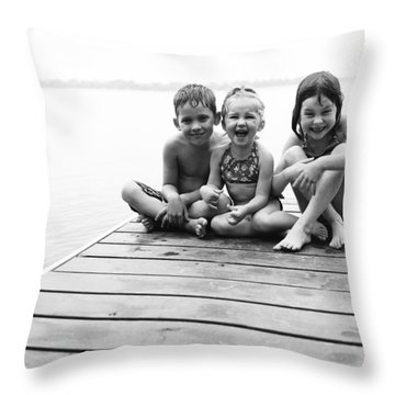 Kids Sitting On Dock Throw Pillow by Michelle Quance