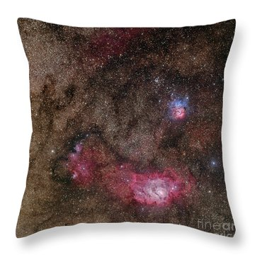 Lagoon Nebula And Trifid Nebula Throw Pillow by Phillip Jones