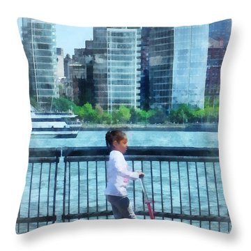 Little Girl On Scooter By Manhattan Skyline Throw Pillow by Susan Savad