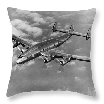 Lockheed Constellation Throw Pillow by Photo Researchers