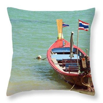 Longtail Boat At Sea Throw Pillow by Bill Brennan