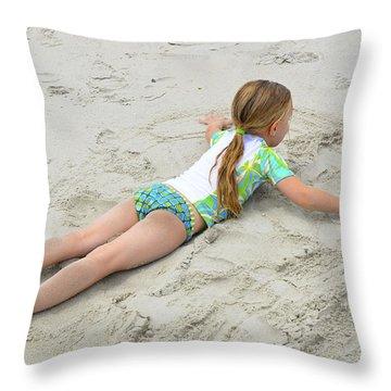 Throw Pillow featuring the photograph Making A Sand Angel by Maureen E Ritter