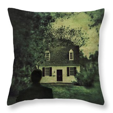 Man In Front Of Cottage Throw Pillow by Jill Battaglia
