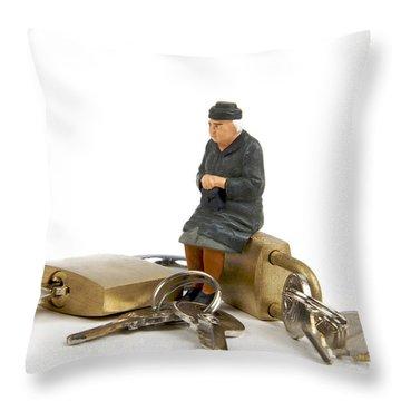 Miniature Figurines Of Elderly Sitting On Padlocks Throw Pillow by Bernard Jaubert