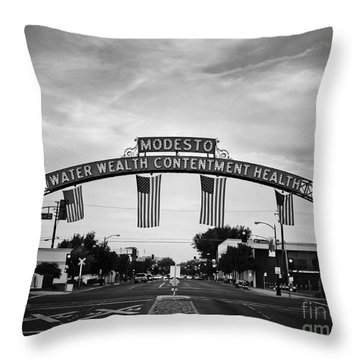 Modesto Arch With Flags Throw Pillow by Jim And Emily Bush