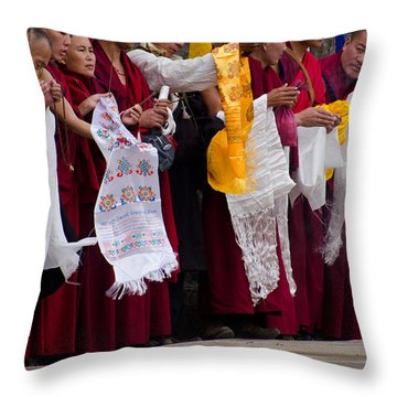 Throw Pillow featuring the photograph Monks Wait For The Dalai Lama by Don Schwartz