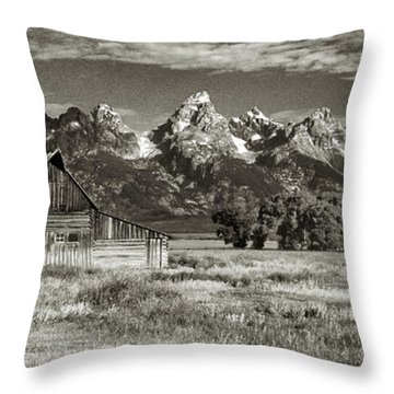 Moulton Barn And The Grand Tetons Throw Pillow by Sandra Bronstein