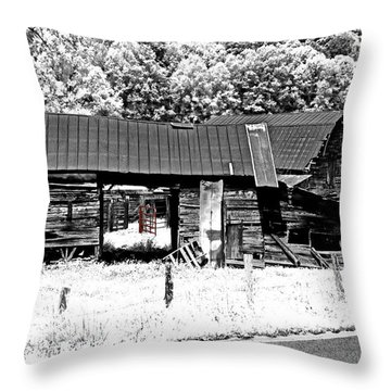 Throw Pillow featuring the photograph Old Barns With Red Gate by Susan Leggett