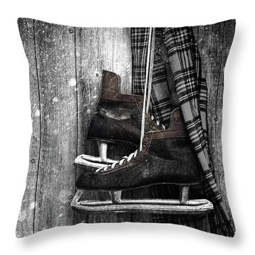Old Ice Skates Hanging On Barn Wall Throw Pillow by Sandra Cunningham