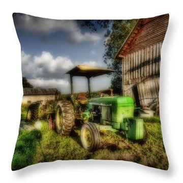 Old Tractor In Field By Barn Throw Pillow by Dan Friend