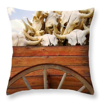 Old Wagon Full Of Buffalo Skulls Throw Pillow by Garry Gay