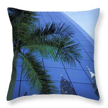 Palm Tree And Reflection Of Petronas Throw Pillow by Axiom Photographic