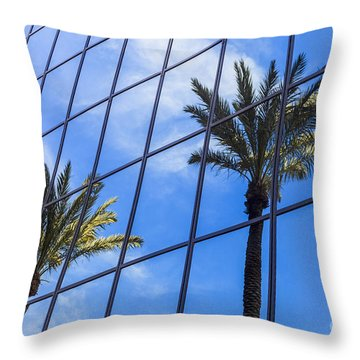 Palm Trees Reflection On Glass Office Building Throw Pillow by Paul Velgos