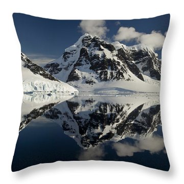 Peaks Along  Neumayer Channel Throw Pillow by Colin Monteath