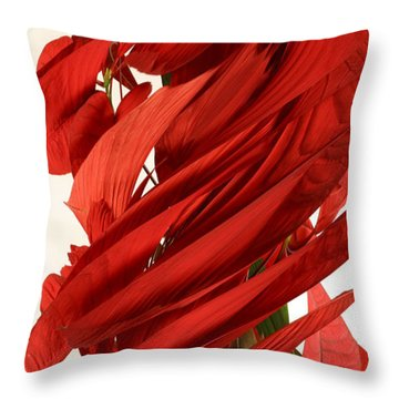 Peripheral Streak Image Of A Poinsettia Throw Pillow by Ted Kinsman