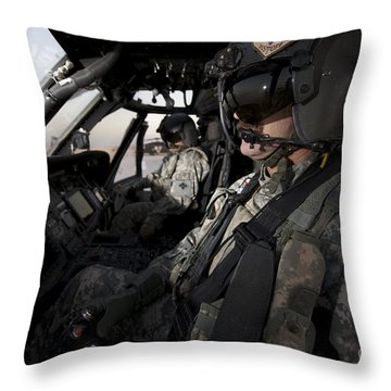 Pilot In The Cockpit Of A Uh-60l Throw Pillow by Terry Moore