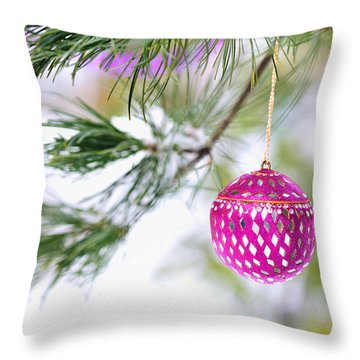 Throw Pillow featuring the photograph Pink Christmas Ornament On Snowy Pine Tree Branch  by Marianne Campolongo