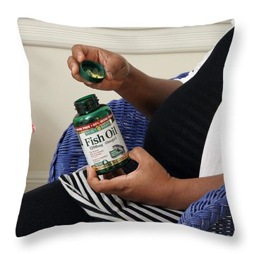 Pregnant Woman Taking Fish Oil Throw Pillow by Photo Researchers