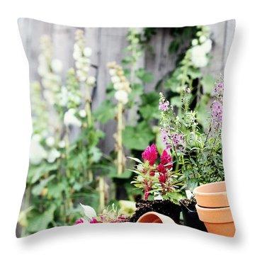 Preparing Flower Pots Throw Pillow by Stephanie Frey