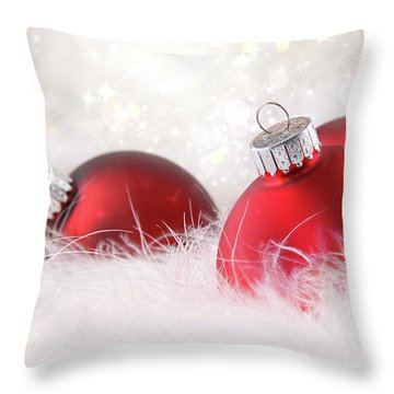 Red Christmas Balls In White Feathers  Throw Pillow by Sandra Cunningham