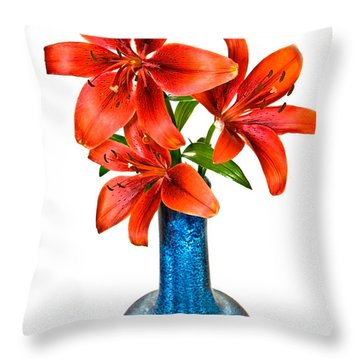 Red Lilies In Blue Vase Throw Pillow by Susan Leggett