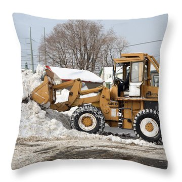 Removing Snow Throw Pillow by Ted Kinsman