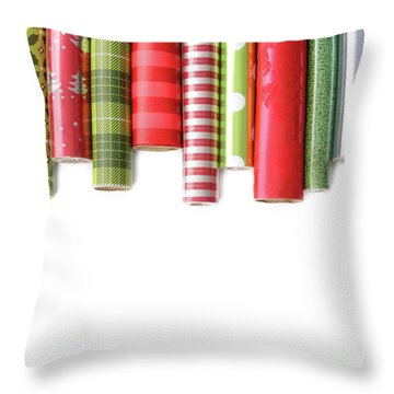Rolls Of Colored Wrapping  Paper On White3 Throw Pillow by Sandra Cunningham