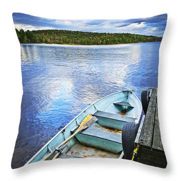 Rowboat Docked On Lake Throw Pillow by Elena Elisseeva