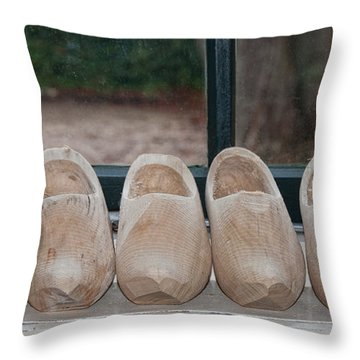 Throw Pillow featuring the digital art Rows Of Wooden Shoes by Carol Ailles