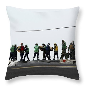 Sailors And Marines Load Supplies Onto Throw Pillow by Stocktrek Images