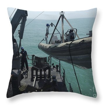 Sailors Lower A Rigid Hull Inflatable Throw Pillow by Stocktrek Images