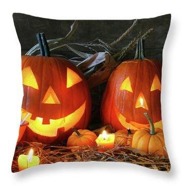 Scarved Jack-o-lanterns  Throw Pillow by Sandra Cunningham