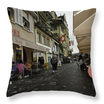 Seated In The Cafe Along The River In Lucerne In Switzerland Throw Pillow by Ashish Agarwal