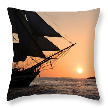 Silhouette Of Tall Ship At Sunset Throw Pillow