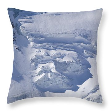 Skiers Cross The Aletsch Glacier En Throw Pillow by Axiom Photographic