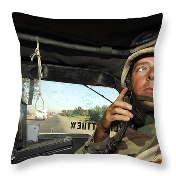 Soldier Monitors The Progress Of A 67 Throw Pillow by Stocktrek Images