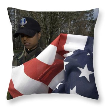 Soldier Unfurls A New Flag For Posting Throw Pillow by Stocktrek Images