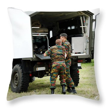Soldiers Of An Infantry Section Throw Pillow by Luc De Jaeger