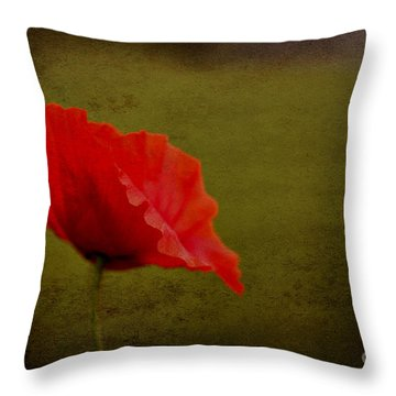 Solitary Poppy. Throw Pillow by Clare Bambers