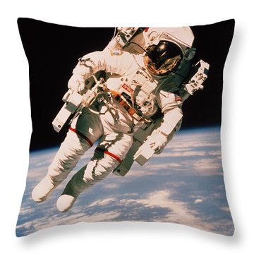Spacewalk Throw Pillow by NASA / Science Source