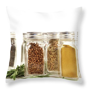 Spice Jars With Fresh Rosmary Leaves Against White Throw Pillow by Sandra Cunningham