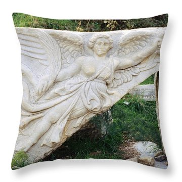 Stone Carving Of Nike Throw Pillow by Mark Greenberg