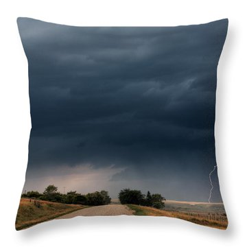 Storm Clouds And Lightning Along A Saskatchewan Country Road Throw Pillow by Mark Duffy