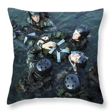 Students Secure A Simulated Casualty Throw Pillow by Stocktrek Images
