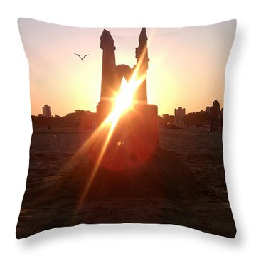 Throw Pillow featuring the photograph Sunset Sunlit Sandcastle With Flying Bird On A Chicago Beach by M Zimmerman